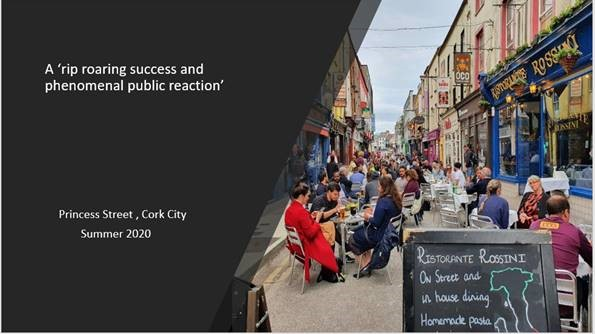 Slide showing Princes St in Cork with people sitting and dining outside at outdoor tables