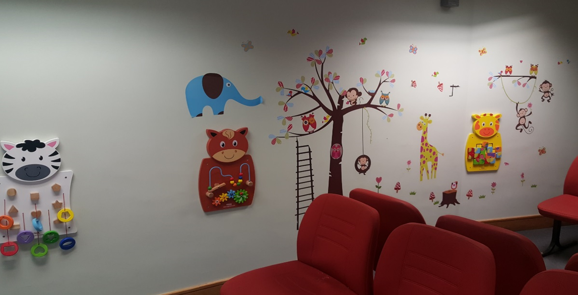 Courts service waiting area with child friendly distractions on the wall