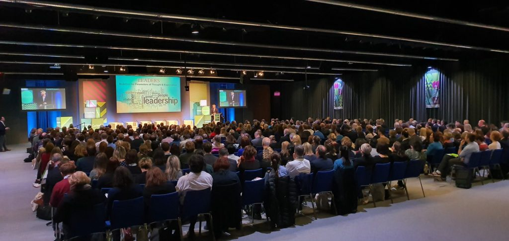 Large crowd and view of the stage at the Innovation Conference