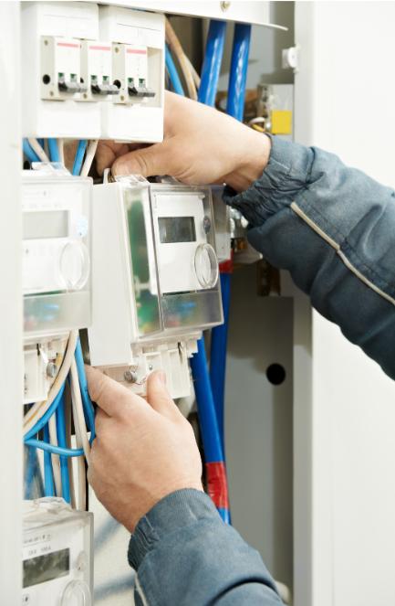 Man checking building energy meter
