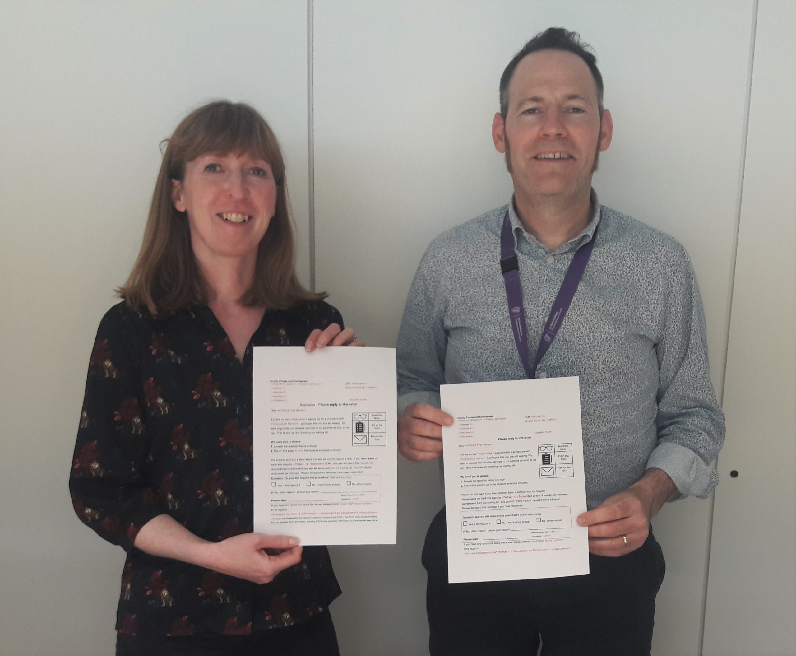 Robert Murphy and Carol Taaffe from Department of Health holding an example of redesigned patient correspondence